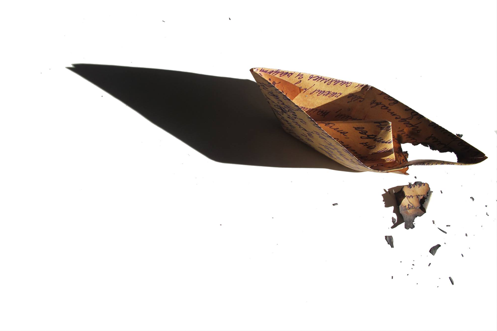 illustration of an old burnt letter folded into a paper boat on a stark white background